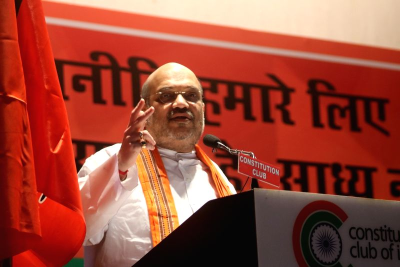 BJP chief Amit Shah addresses during a programme organised on party's foundation day in New Delhi, on April 6, 2016. - Amit Shah
