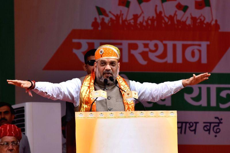 BJP chief Amit Shah addresses during a public meeting to start 'Suraj Gaurav Yatra' at JK Stadium in Rajsamand of Rajasthan on Aug 4, 2018. - Amit Shah