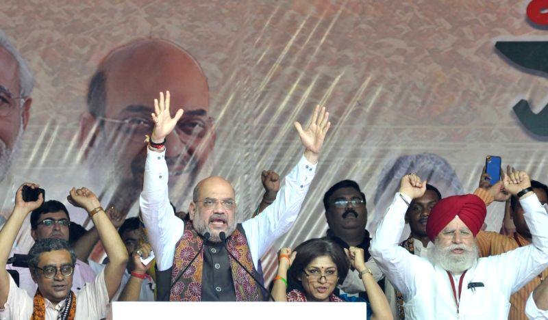 BJP chief Amit Shah addresses during a rally at Kolkata's Mayo Road on Aug 11, 2018. - Amit Shah
