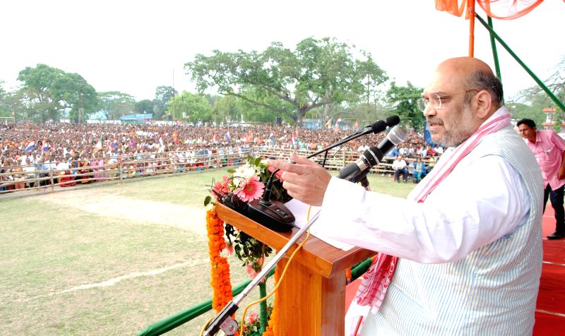 BJP chief Amit Shah addresses during a rally in Kamrup district of Assam ahead of the second phase of state assembly elections on April 5, 2016. - Amit Shah