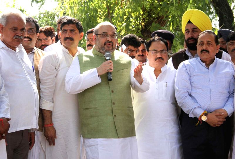 BJP chief Amit Shah addresses during his visit to a higher secondary school in R.S. Pura area of Jammu where villagers from the border areas have taken shelter because of Pakistani firing on Aug 25, .