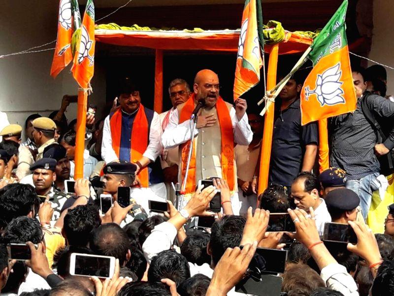 BJP chief Amit Shah addresses during his visit to Kotiyajote in Naxalbari near Siliguri on April 25, 2017. - Amit Shah