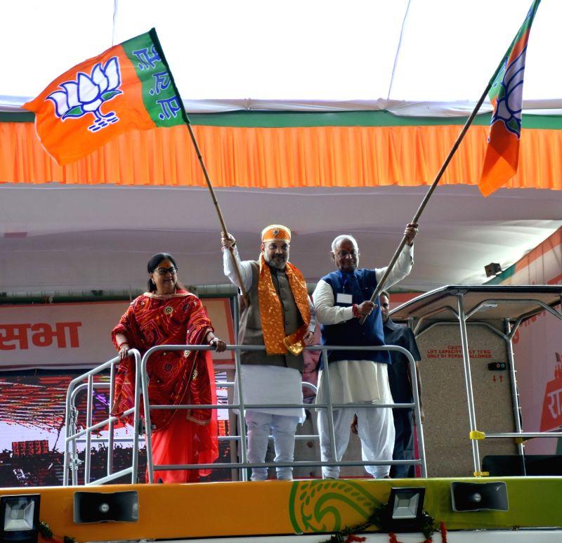 BJP chief Amit Shah along with Rajasthan Chief Minister Vasundhara Raje and state BJP president Madan Lal Saini flag off the 'Suraj Gaurav Yatra' in a customised bus at Kankroli village in ... - Vasundhara Raje and Amit Shah
