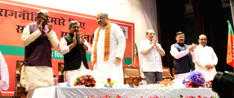 BJP chief Amit Shah and party's Delhi unit chief Satish Upadhyay during a programme organised on party's foundation day in New Delhi, on April 6, 2016. - Amit Shah and Satish Upadhyay