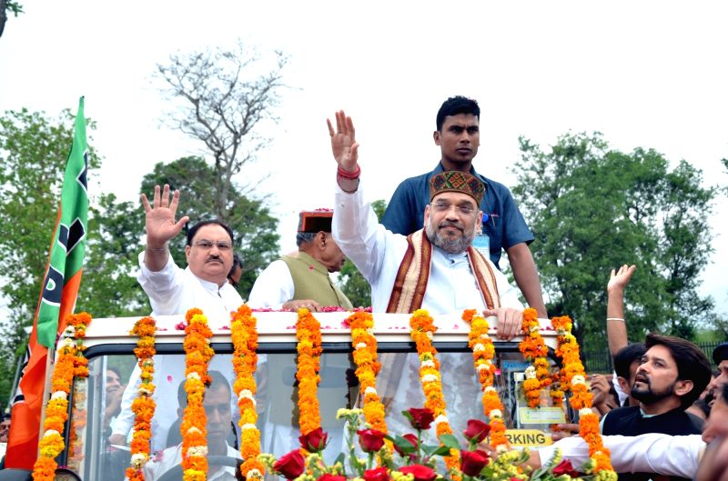 BJP chief Amit Shah and Union Minister JP Nadda during a roadshow in Palampur on May 3, 2017. - J and Amit Shah