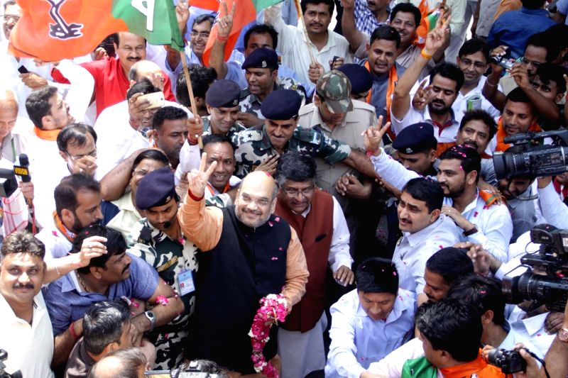 BJP chief Amit Shah and Union Telecom Minister Ravi Shankar Prasad celebrate party's performance in the recently concluded 2016 Assam Assembly Polls in New Delhi, on May 19, 2016. - Ravi Shankar Prasad and Amit Shah
