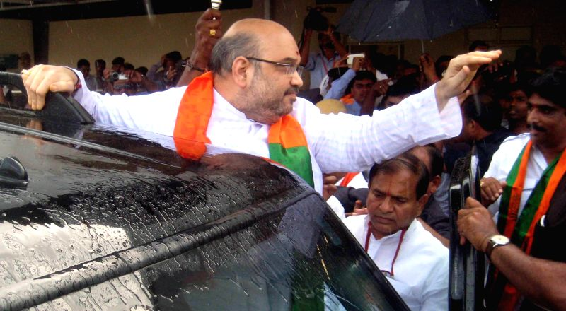 BJP chief Amit Shah arrives at Shamshabad Airport in Hyderabad on Aug 21, 2014.