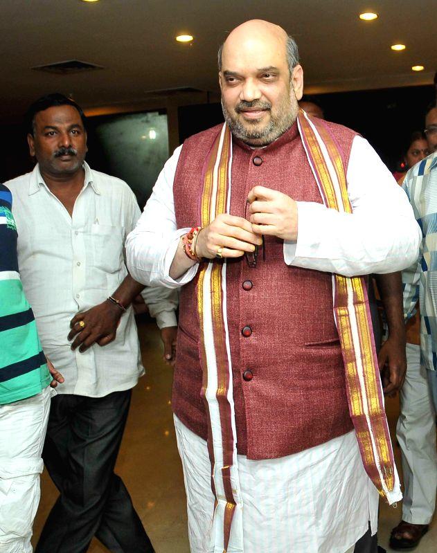 BJP chief Amit Shah arrives to meet Andhra Pradesh Chief Minister N. Chandrababu Naidu at his residence in Hyderabad on Aug 22, 2014. - N. Chandrababu Naidu
