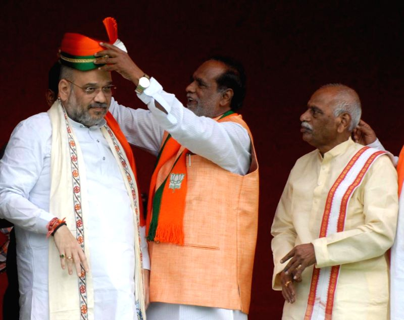 BJP chief Amit Shah being felicitated by Telangana BJP chief K Laxman on his arrival in Hyderabad on July 13, 2018. Also seen party MP Bandaru Dattatreya. - Amit Shah
