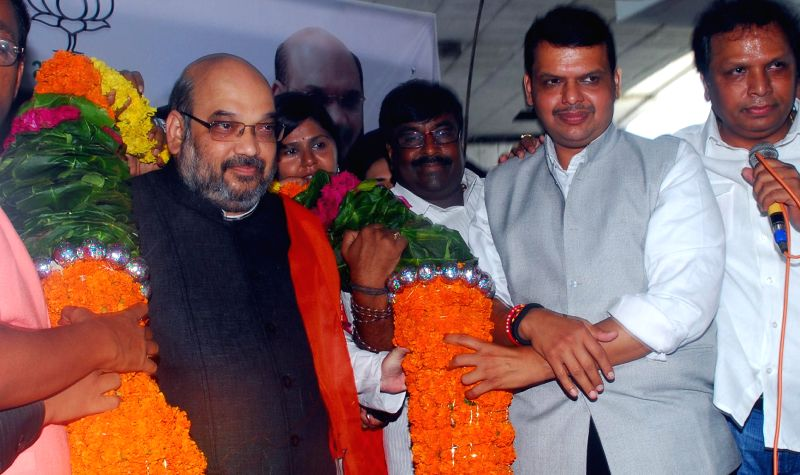 BJP chief Amit Shah being felicitated by party workers on his arrival in Mumbai on Sept 4, 2014. Also seen Maharashtra BJP chief Devendra Fadnavis.