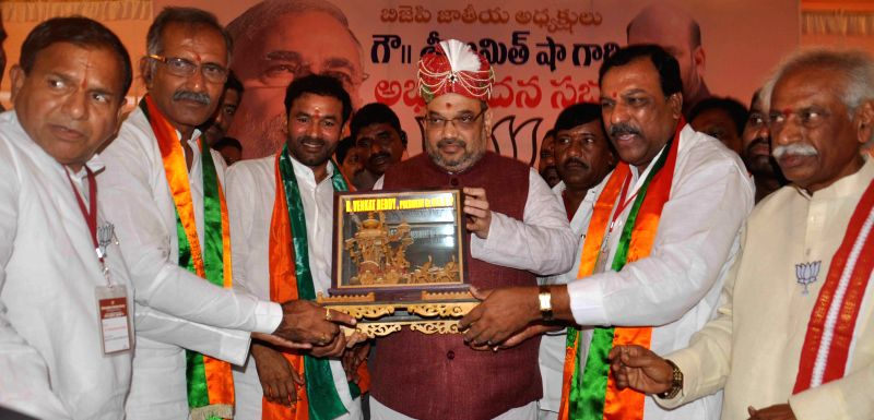 BJP chief Amit Shah being felicitated during a party programme in Secunderabad on Aug 21, 2014. Also seen BJP leader Bandaru Dattatreya.