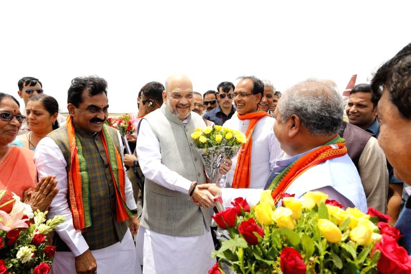 BJP chief Amit Shah being received by Madhya Pradesh Chief Minister Shivraj Singh Chouhan on his arrival in Jabalpur on June 12, 2018. - Shivraj Singh Chouhan and Amit Shah