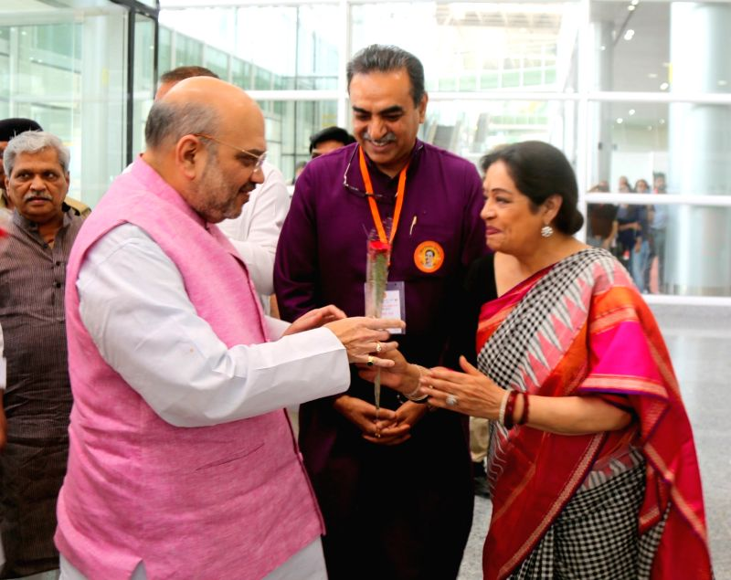 BJP chief Amit Shah being welcomed by BJP MP Kirron Kher in Chandigarh on May 20, 2017. Shah on a two-day visit as part of his country-wide 95-day tour. - Amit Shah and Kirron Kher