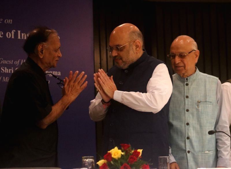 """BJP chief Amit Shah being welcomed during during National Conference on """"Reforming Agrarian Economy: Role of Insurance"""", in New Delhi on July 21, 2018. - Amit Shah"""