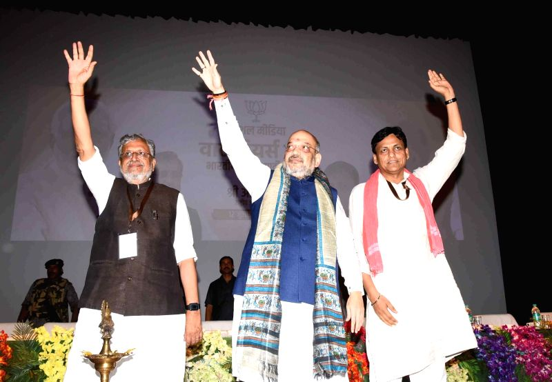BJP chief Amit Shah, Bihar Deputy Chief Minister and BJP leader Sushil Kumar Modi and BJP state president Nityanand Rai wave at party workers, during a party meeting, in Patna on July 12, 2018. - Amit Shah, Sushil Kumar Modi and Nityanand Rai