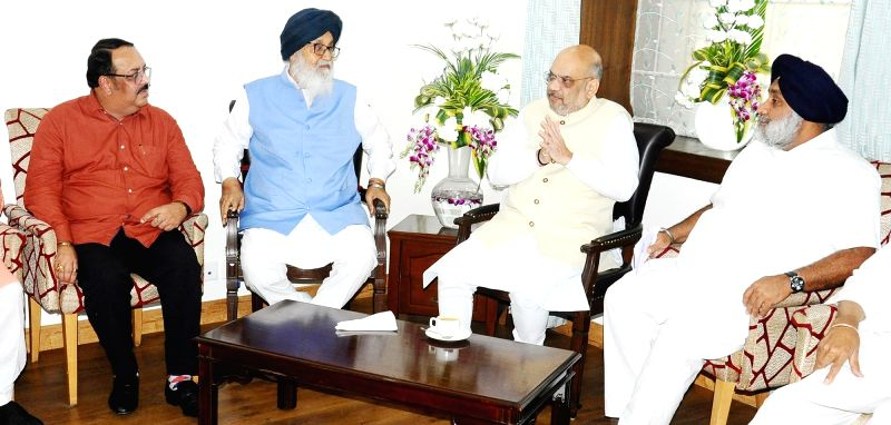 BJP chief Amit Shah calls on Shiromani Akali Dal patron Parkash Singh Badal and his son and party President Sukhbir Singh Badal in Chandigarh, on June 7, 2018. - Amit Shah, Parkash Singh Badal and Sukhbir Singh Badal