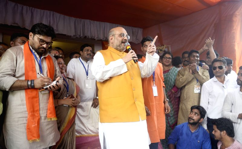 BJP chief Amit Shah campaigns for in Bhabanipur Vidhan Sabha constituency in Kolkata on April 26, 2017. Also seen Union Minister Babul Supriyo. - Babul Supriyo and Amit Shah