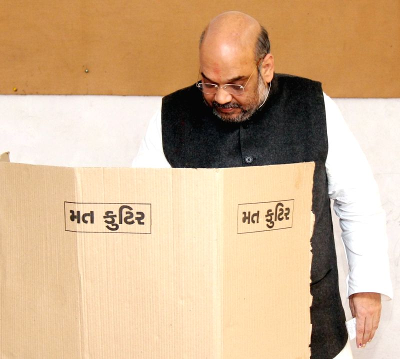 BJP chief Amit Shah casts his vote during the first phase of the two-phase local body elections in Ahmedabad, on Nov 22, 2015.