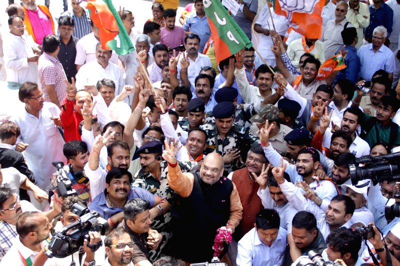 BJP chief Amit Shah celebrates party's performance in the recently concluded 2016 Assam Assembly Polls in New Delhi, on May 19, 2016. - Amit Shah