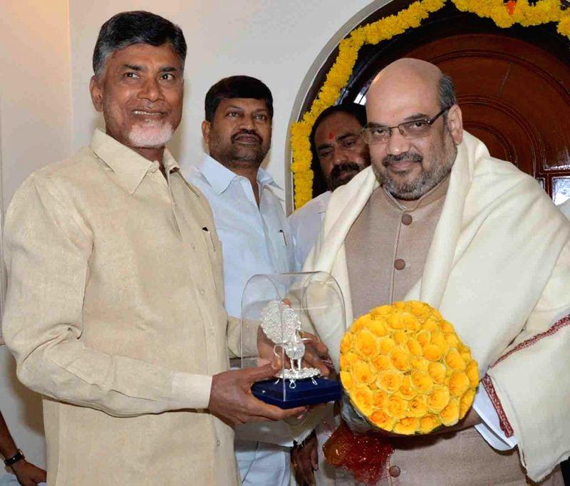 BJP chief Amit Shah during a meeting with Andhra Pradesh Chief Minister N. Chandrababu Naidu at his residence in Hyderabad on Aug 22, 2014. - N. Chandrababu Naidu