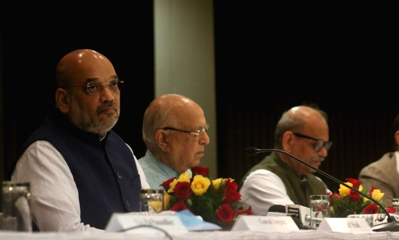 """BJP chief Amit Shah during National Conference on """"Reforming Agrarian Economy: Role of Insurance"""", in New Delhi on July 21, 2018. - Amit Shah"""