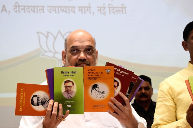 BJP chief Amit Shah during the launch of Pandit Deendayal Upadhyaya Prashikshan Mahabhiyan books, in New Delhi on June 13, 2018. - Amit Shah