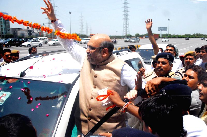 BJP chief Amit Shah enroute to Haryana's Mahendergarh to attend Vijay Sankalp Rally in Gurgaon on Aug 14, 2014. - Amit Shah
