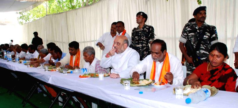 BJP chief Amit Shah haves lunch with farmers in Nalgonda district of Telangana on May 22, 2017. - Amit Shah