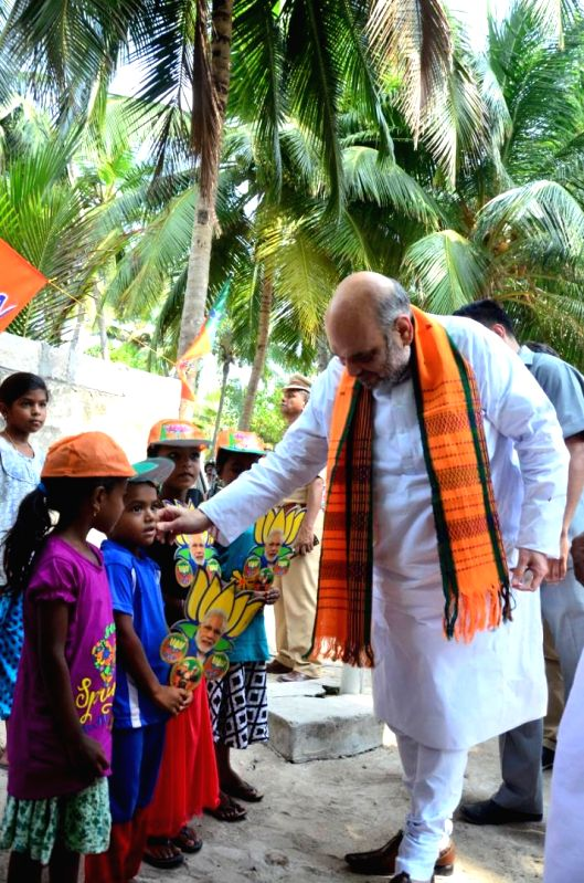 BJP chief Amit Shah interacts with children at Kavaratti, the capital of Lakshadweep on May 17, 2017. - Amit Shah