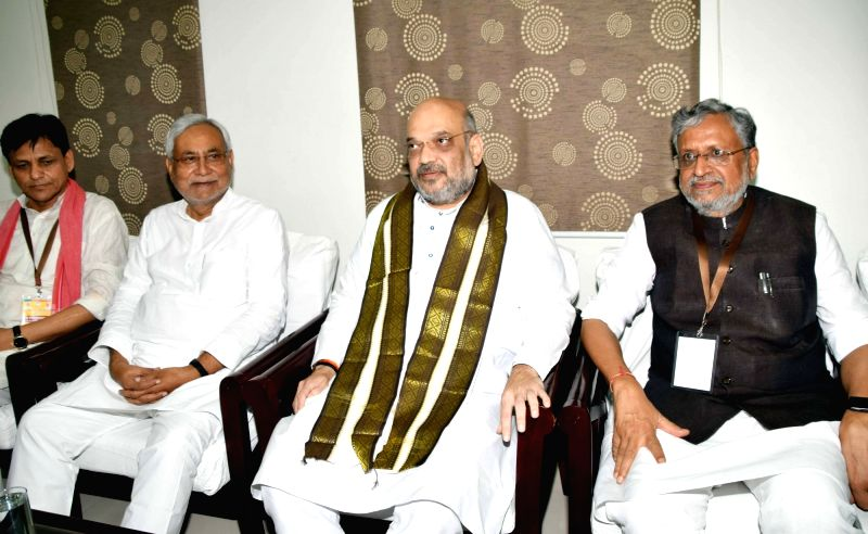 BJP chief Amit Shah meets Bihar Chief Minister and JD-U chief Nitish Kumar, in Patna on July 12, 2018. Also seen Bihar Deputy Chief Minister and BJP leader Sushil Kumar Modi and BJP state ... - Amit Shah, Nitish Kumar, Sushil Kumar Modi and Nityanand Rai