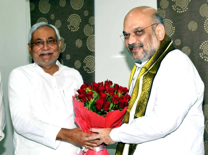 BJP chief Amit Shah meets Bihar Chief Minister and JD-U chief  Nitish Kumar, in Patna on July 12, 2018. - Amit Shah and Nitish Kumar