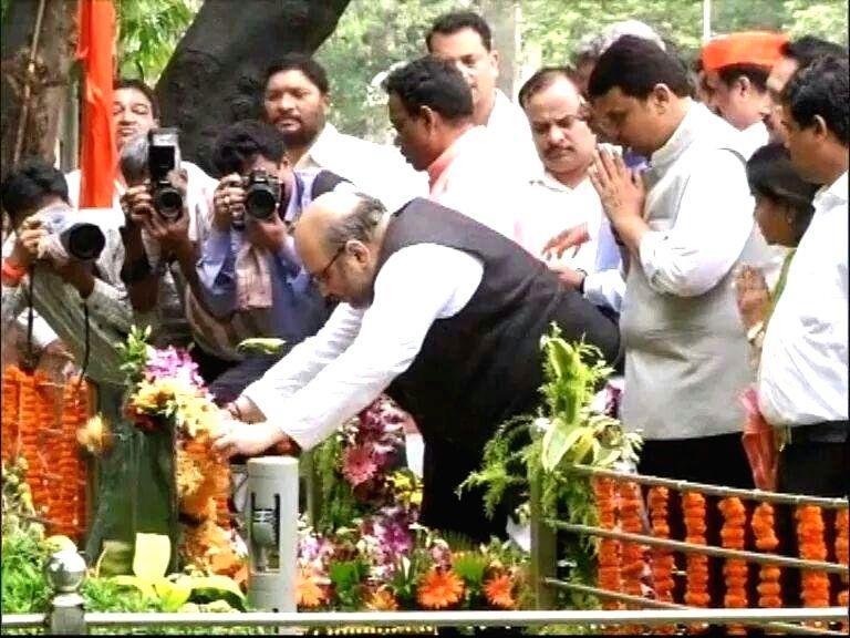 BJP chief Amit Shah pays homage to Shiv Sena founder Bal Thackeray in Mumbai on Sept 4, 2014.