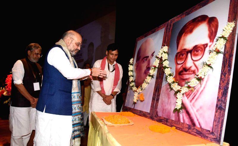 BJP chief Amit Shah pays tributes to Bharatiya Jana Sangh founder Syama Prasad Mookerjee and co-founder Deendayal Upadhyay, during a party meeting, in Patna on July 12, 2018. Also seen Bihar ... - Amit Shah, Deendayal Upadhyay, Sushil Kumar Modi and Nityanand Rai