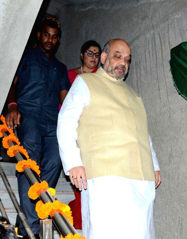 BJP chief Amit Shah visits party workers residence at Keshtopur in Kolkata on April 27, 2017. - Amit Shah