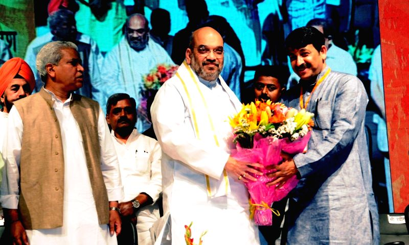 BJP chief Amit Shah with Delhi Party chief Manoj Tiwari during a programme organised to celebrate party's success in the recent Delhi MCD polls in New Delhi on April 2, 2017. - Amit Shah