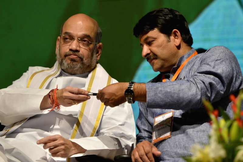 BJP chief Amit Shah with Delhi Party chief Manoj Tiwari during a programme organised tocelebrate party's success in the recent Delhi  MCD polls in New Delhi on April 2, 2017. - Amit Shah