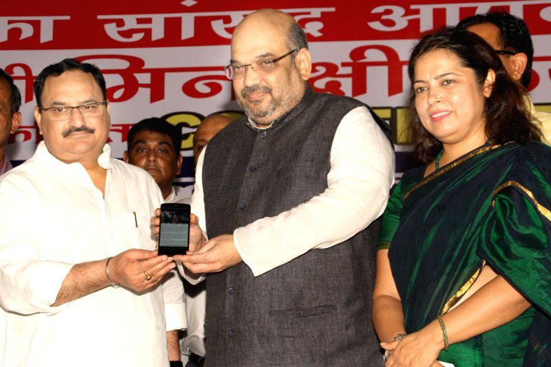 BJP chief Amit Shah with party leader Meenakshi Lekhi during launch of a mobile governance application in New Delhi on July 28, 2014.
