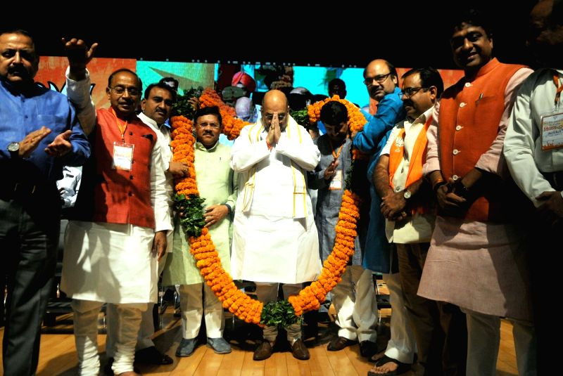 BJP chief Amit Shah with party leaders Manoj Tiwari, Vijay Goel and others during a programme organised to celebrate party's success in the recent Delhi MCD polls in New Delhi on April 2, ... - Amit Shah
