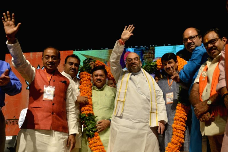 BJP chief Amit Shah with party leaders Manoj Tiwari, Vijay Goel and others during aprogramme organised to celebrate party's success in the recent Delhi MCD polls in New Delhi on April 2, ... - Amit Shah