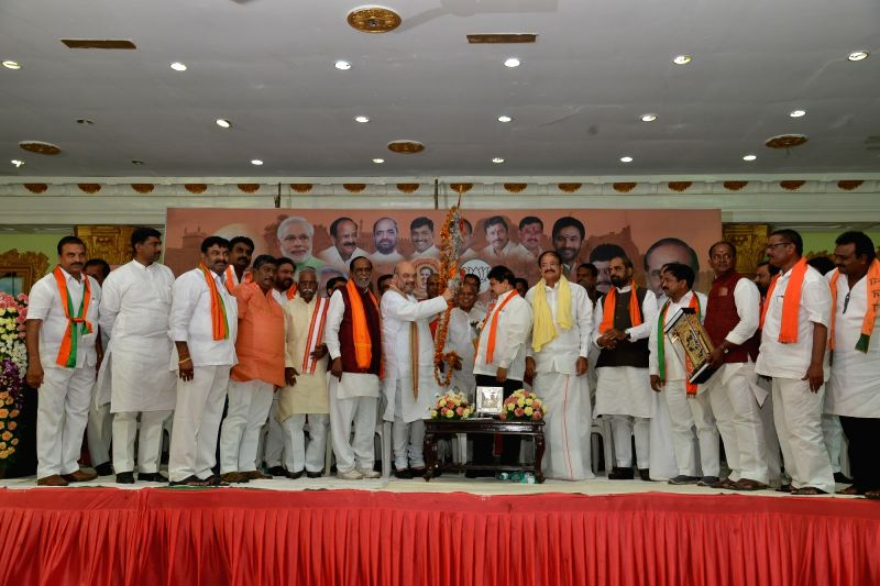 BJP chief Amit Shah with party leaders Venkaiah Naidu and Bandaru Dattatreya during a party meeting in Hyderabad on May 24, 2017. - Venkaiah Naidu and Amit Shah