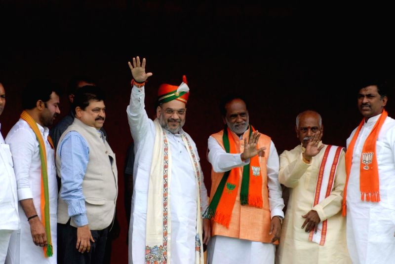 BJP chief Amit Shah with Telangana BJP chief K Laxman, G Kishan Reddy and other party leaders during a programme organised to felicitate him on his arrival in Hyderabad on July 13, 2018. - Amit Shah and G Kishan Reddy