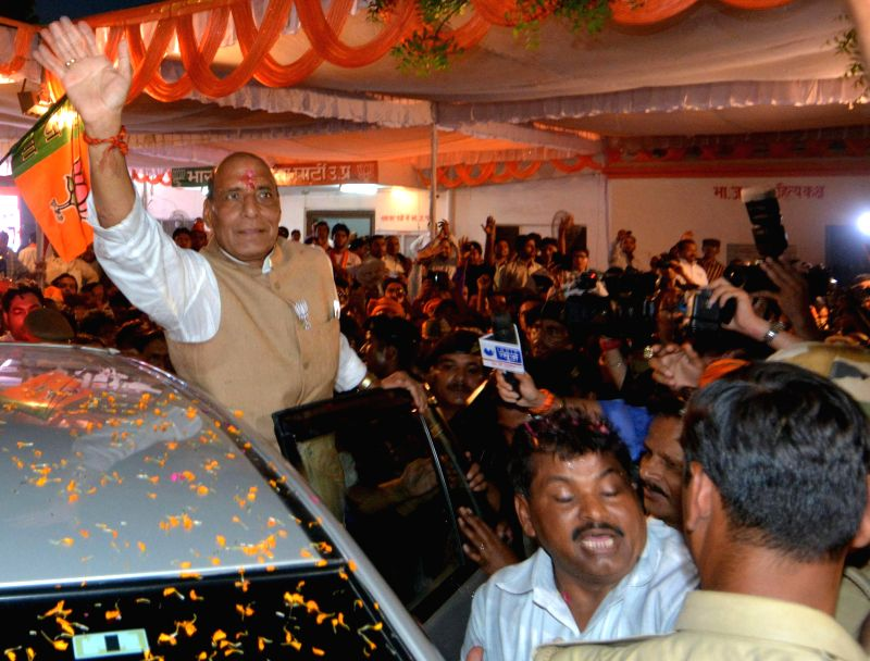 BJP chief Rajnath Singh receives a grand welcome in Lucknow after party's excellent performance in 2014 Lok sabha Elections on May 16, 2014.