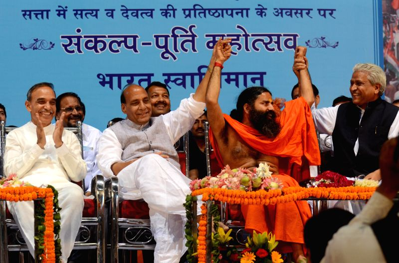 BJP chief Rajnath Singh with Yoga guru Ramdev and party leader and former police commissioner of Mumbai Satyapal Singh during Sankalp Purty Mahotsav organised by Bharat Swabhiman Trust in New Delhi .. - Rajnath Singh and Satyapal Singh