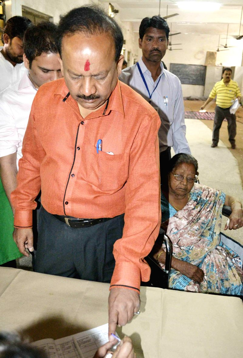 BJP Delhi unit president and candidate for 2014 Lok Sabha Election from Chandni Chowk, Harsh Vardhan shows his fore finger marked with phosphoric ink after casting his vote during the third phase of .