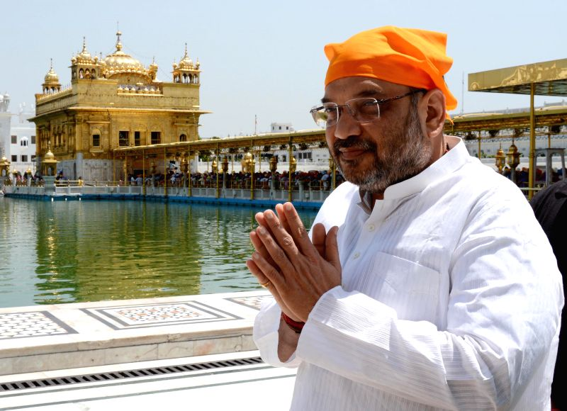 BJP general secretary Amit Shah pays obeisance at the Golden Temple in Amritsar on April 28, 2014.