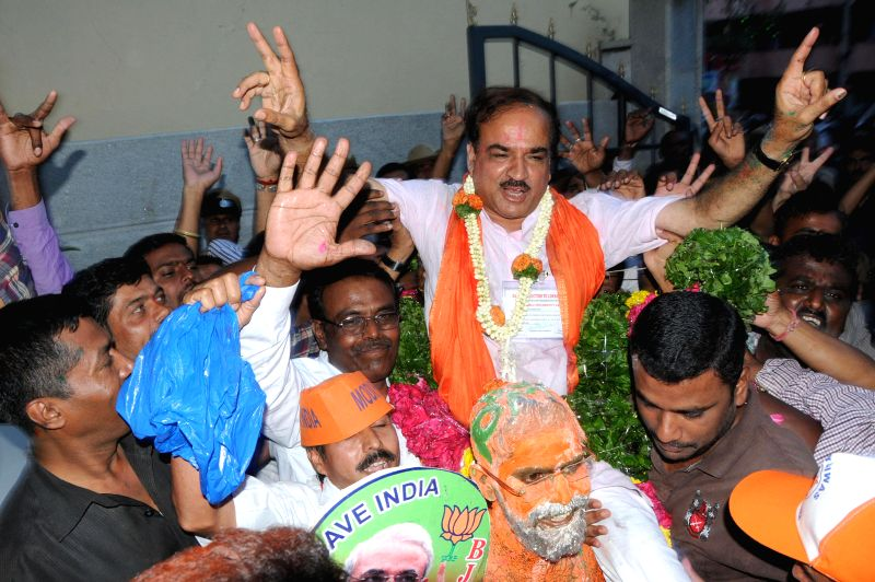 BJP leader Ananth Kumar celebrates after winning Bangalore South Lok Sabha seat at BJP office in Bangalore on May 16, 2014.