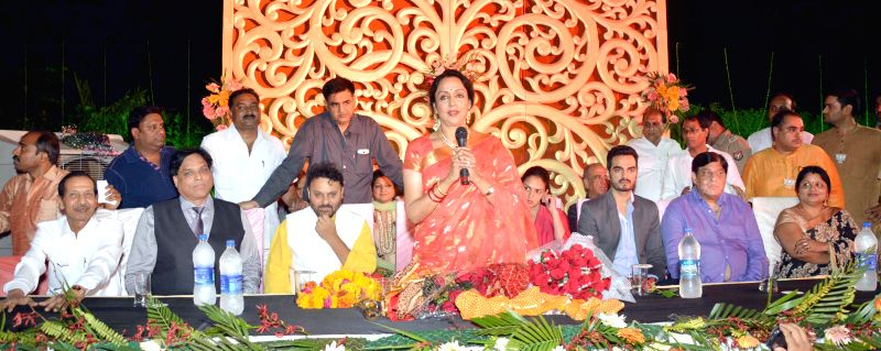 BJP leader and actress Hema Malini addresses party workers after winning Mathura Lok Sabha seat, in Mathura on May 17, 2014.