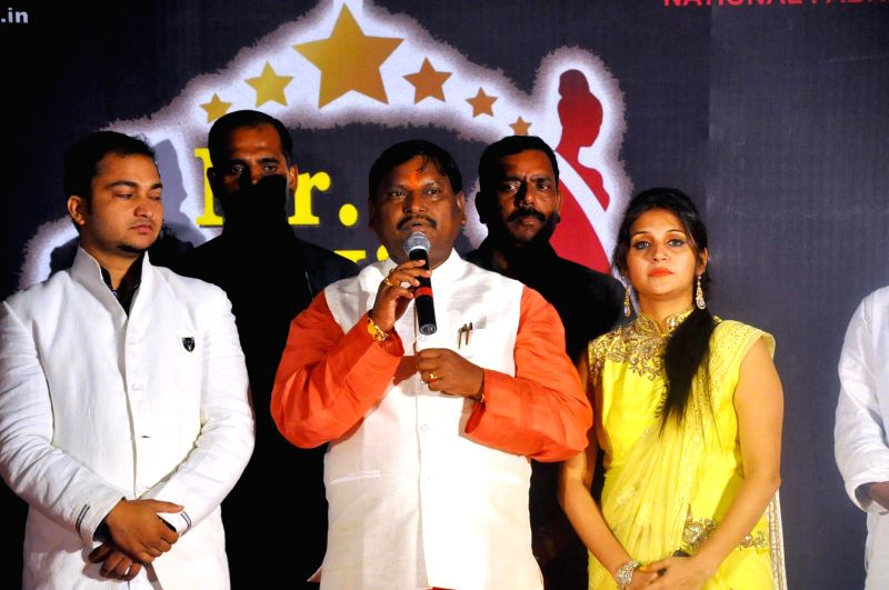 BJP leader and former Jharkhand Chief Minister Arjun Munda addresses during Mr. Jharkhand and Miss Jharkhand Contest 2014, in Ranchi on Aug 10, 2014. - Arjun Munda