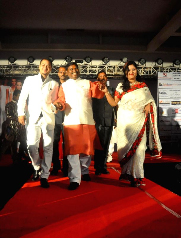 BJP leader and former Jharkhand Chief Minister Arjun Munda walks the ramp during Mr. Jharkhand and Miss Jharkhand Contest 2014, in Ranchi on Aug 10, 2014.