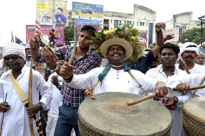 BJP leader and former Jharkhand Chief Minister Arjun Munda participates in World Indigenous Day celebrations in traditional attire in Ranchi on Aug 9, 2016. - Arjun Munda